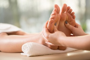 Close-up of young woman having reflexology, horizontal