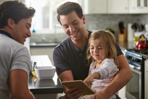 bigstock-Male-gay-dads-use-tablet-with-1273507791